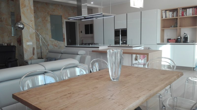 living room table and breakfast table in solid wood, sofas and easy chair