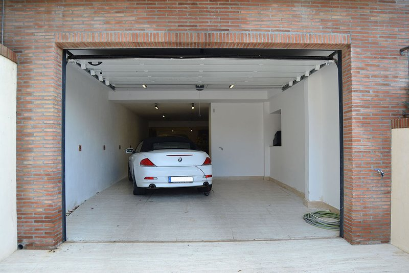 Garage for 2 cars plus 2 secure places inside the gate