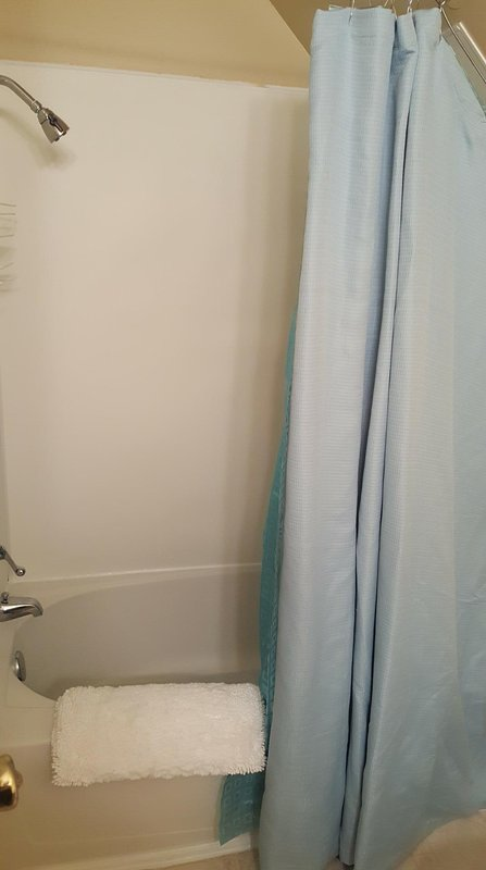 The upstairs bath has a tub/shower combo.