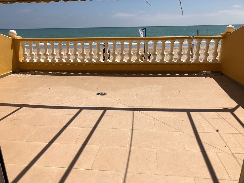 40 m2 private terrace accessible from the living room. awning has tables and chairs.