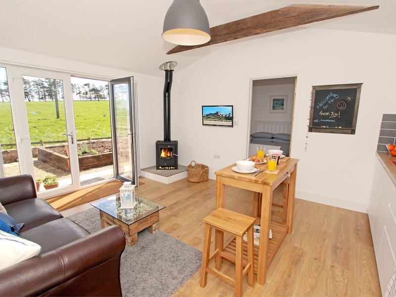 Enjoy cosy evenings snuggled up in front of the wood burning stove