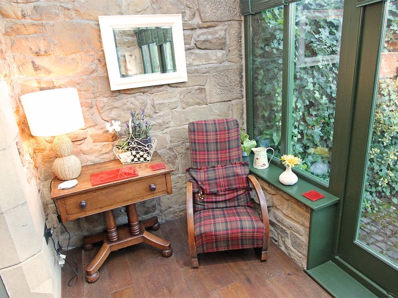 Curl up with your book and look onto the garden patio