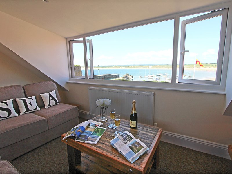 Views over the very nearby Beadnell Bay from the top floor living area