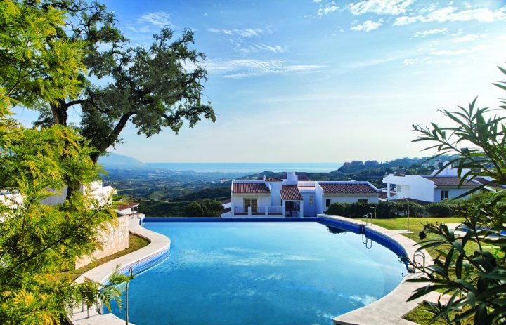 The community pool with panoramic sea and mountain views.
