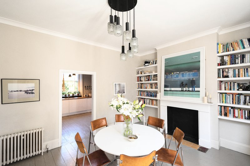 Spacious dining room with large bay window & seating for 8.