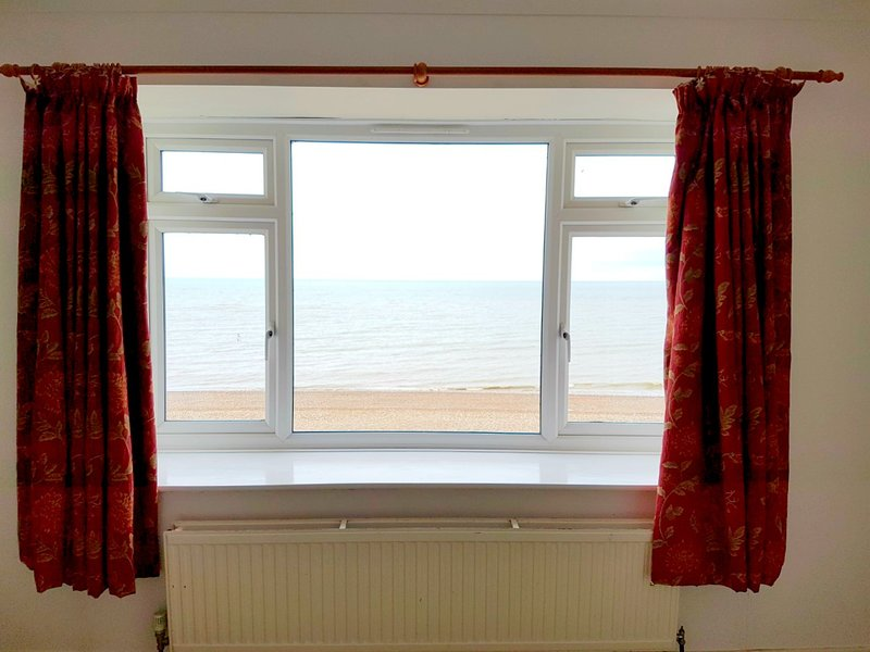 views from master bedroom of the beach and sea