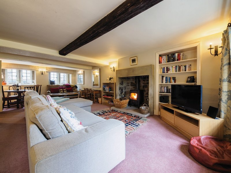 Stunning lounge with cosy wood burner