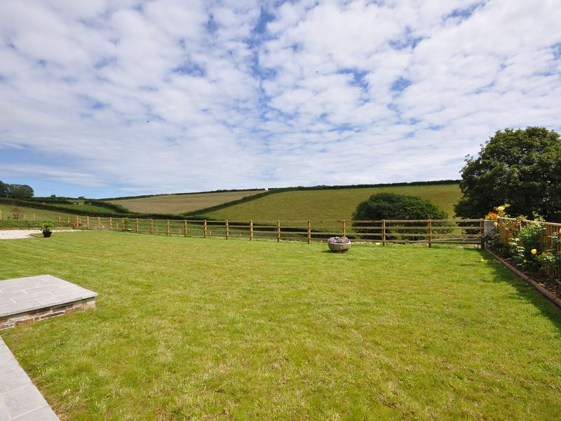 Spacious garden with views across the surrounding fields
