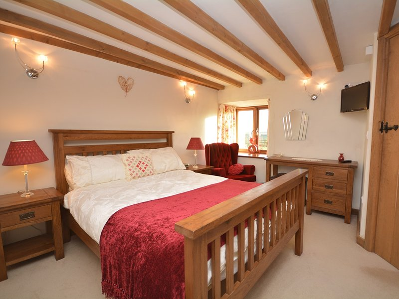 Double bedroom with TV and en-suite shower room