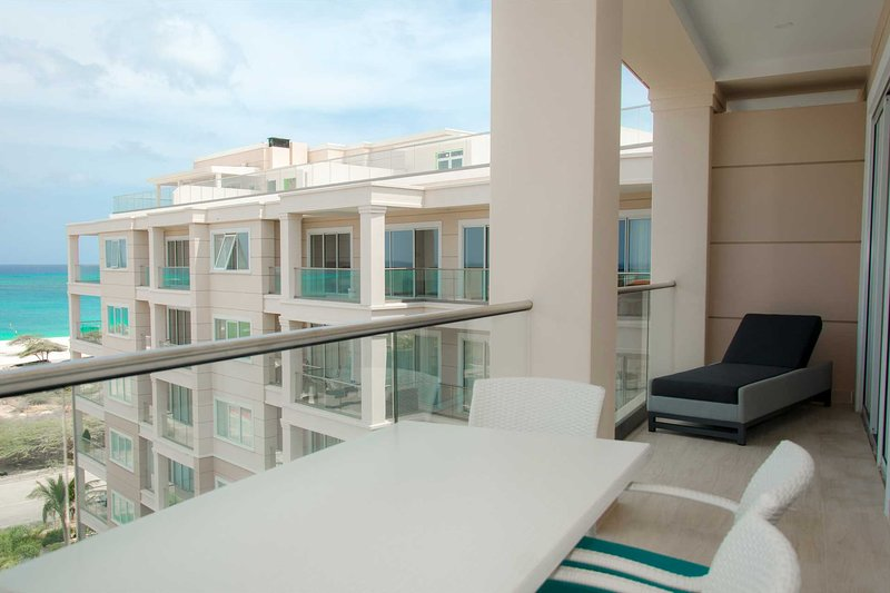 Your stunning view from the balcony with 4-seat dining table and a lounge chair