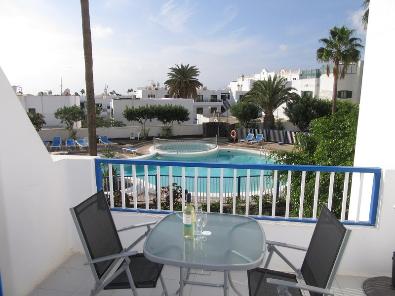 The balcony overlooks the communal pool, has sun for much of the day and is a relaxing place to sit