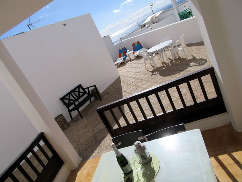 The apartment has amazing outdoor space, where you can have sun and shade all day long