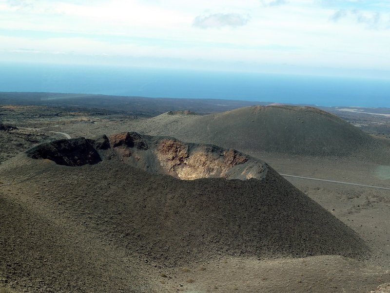 Take a tour around the strange volcanic landscape in the Timanfaya National Park