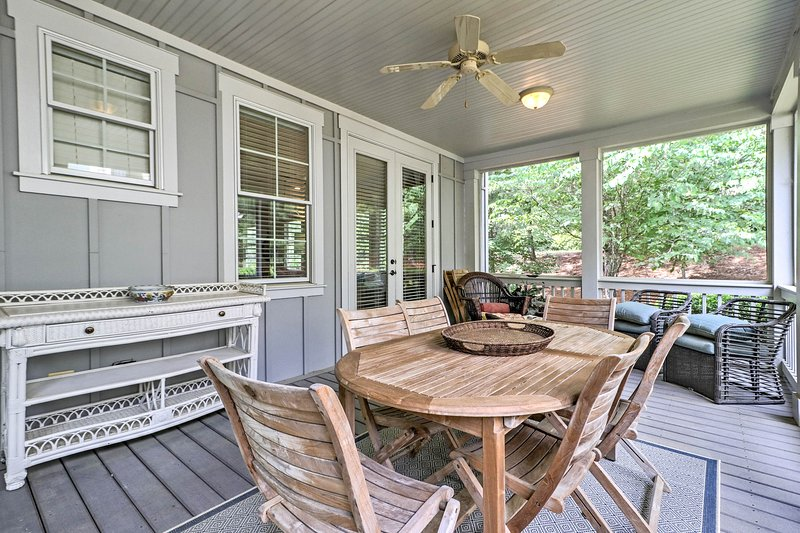 The 3-bedroom, 3.5-bathroom cottage also has a lovely screened-in porch.
