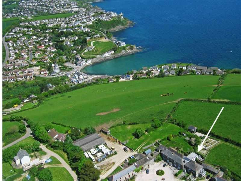 Aerial view of Bodrugan Farm and coast