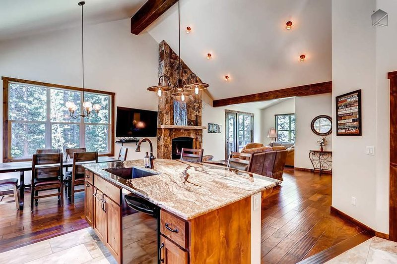 The open floor plan connects the living, dining, kitchen areas and makes for a great gathering space.