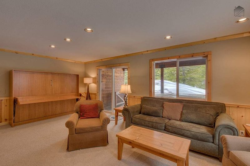 It is here you'll find an additional queen-sized Murphy bed hidden in the wall, and access to your hot tub.