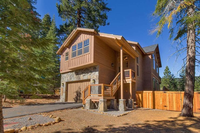 This North Lake Tahoe stunner, nestled amongst the pines and decked out in cedar, has a gorgeous entry and a two-car garage.