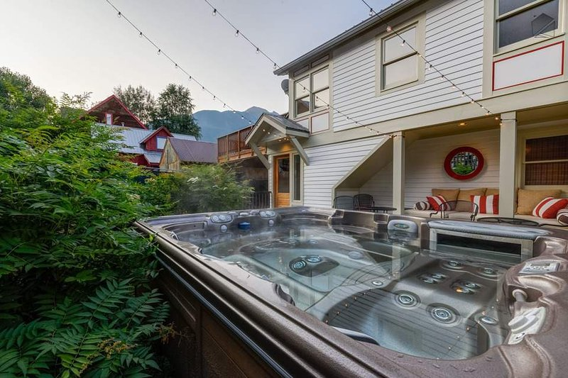The private hot tub on the lower patio is perfect in any season.