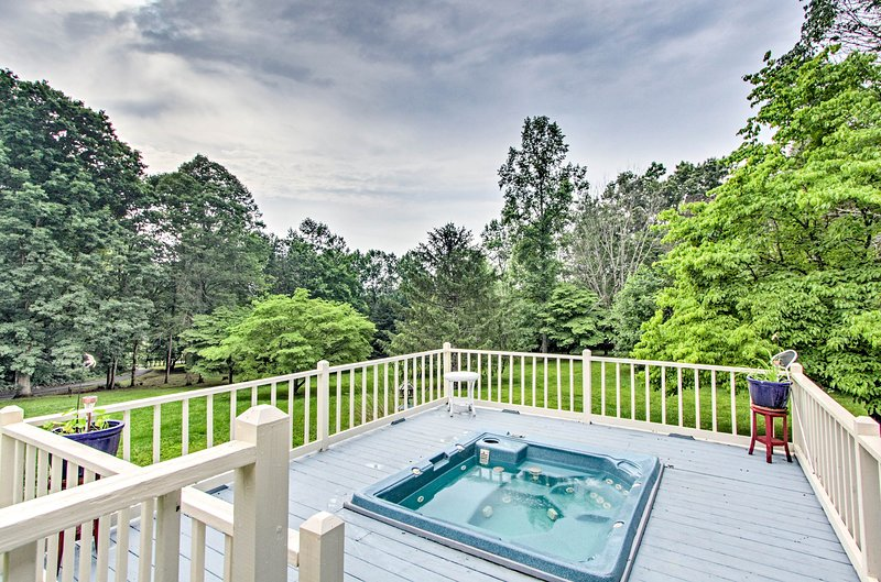 Soak in the hot tub as you watch the sunset paint the sky.