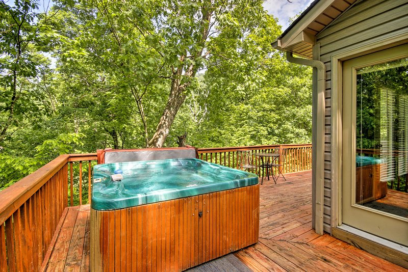 Soak in the private hot tub with your party of 20 in this spacious property.