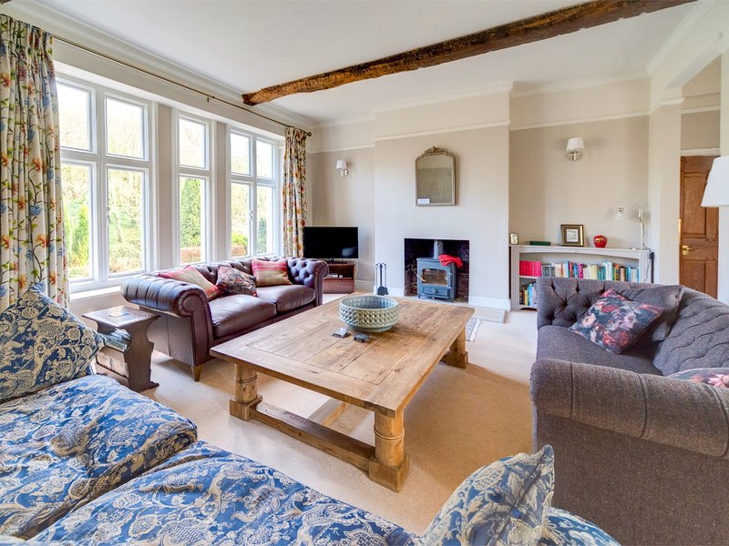The lounge with wood burner and a picture perfect view of the gardens