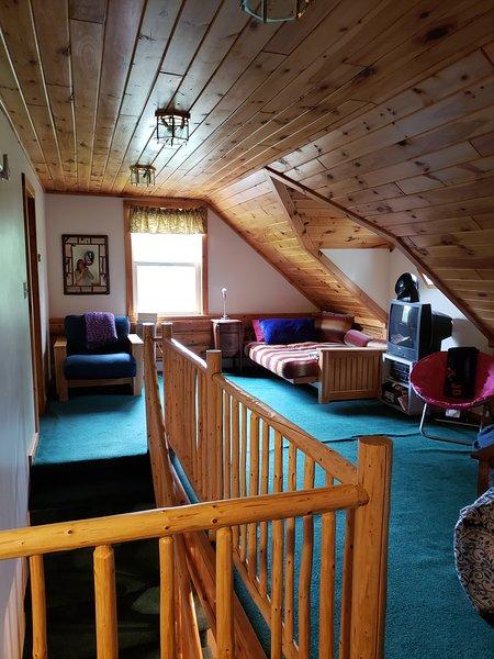 Boven loft met futons