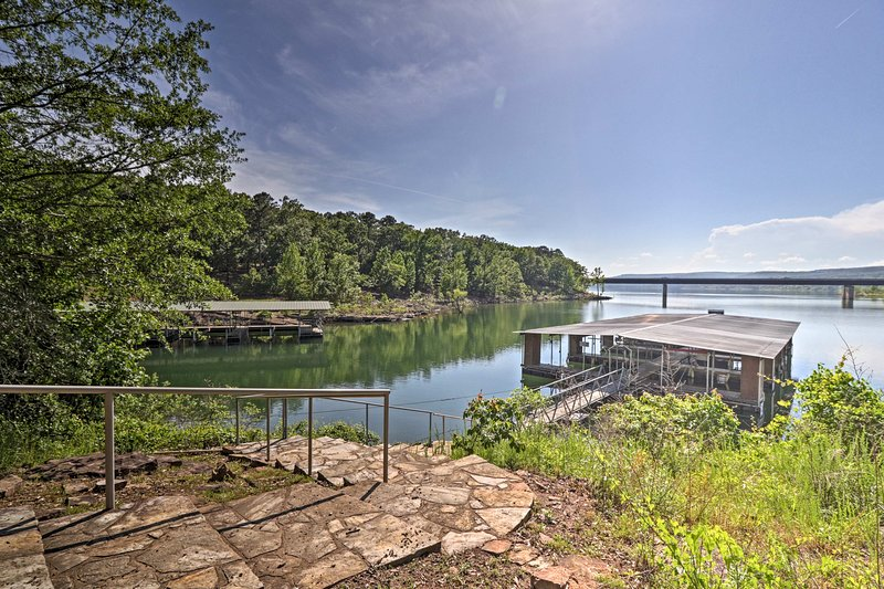 Enjoy the Arkansas wilderness when you stay at this vacation rental home right by the water.