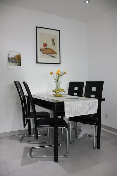 Dining area. The table can also be pulled out when needed.