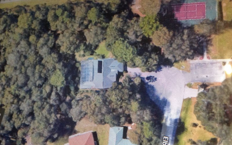 Aerial view. Set in an acre of woodland adjacent to tennis court. Totally secluded pool deck