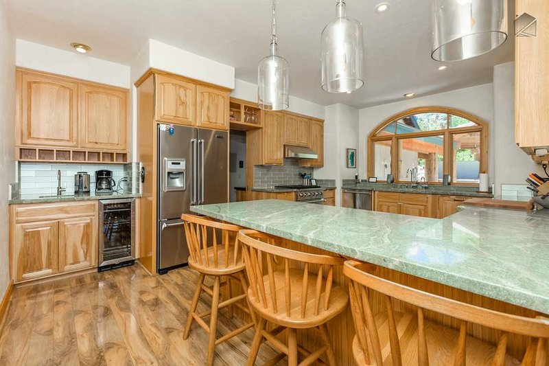 You'll find upgraded appliances in the expansive kitchen which features a breakfast bar for 4.