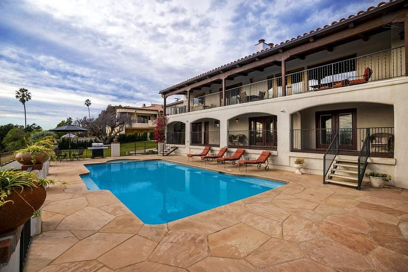 The deck, pool, and hot tub combine to make lounging here a memorable experience.