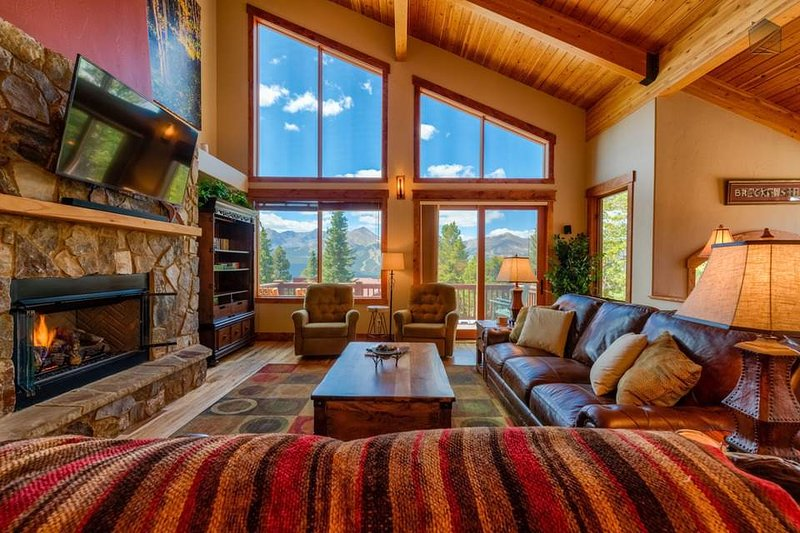 Enjoy stunning mountain views through a wall of windows in the great room.