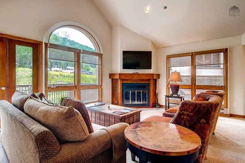 The spacious living room receives tons of natural light, so enjoy your cup of coffee here in the morning.