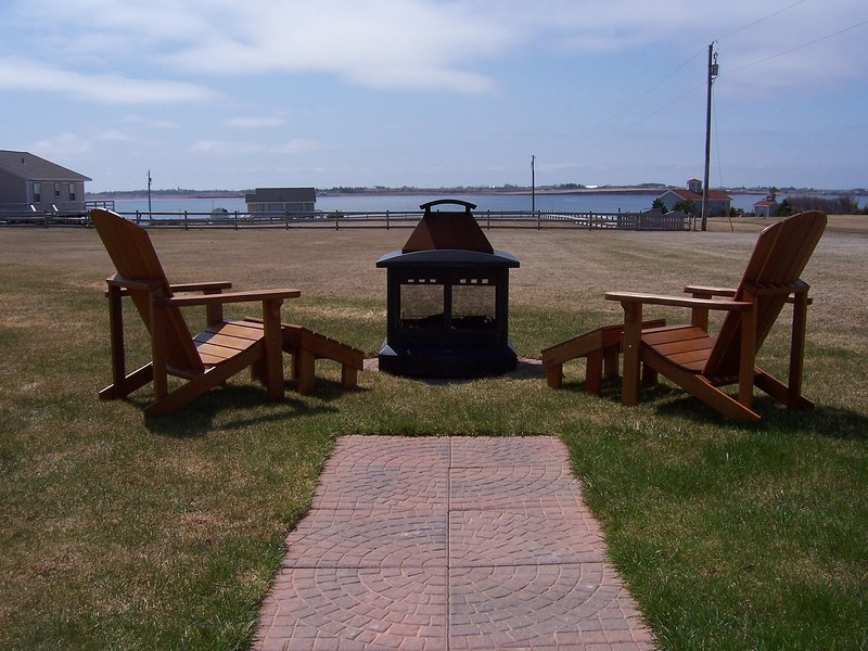 Outdoor fireplace - comes with a view of Darnley Basin and some amazing sunsets.