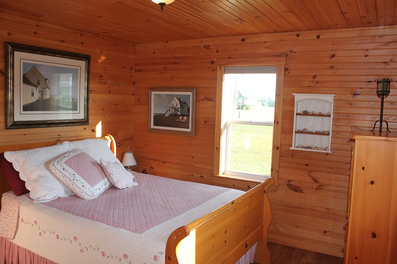 The master bedroom features a comfortable queen size sleigh bed.