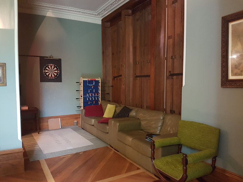 Games room with table football, dart board and comfy seating