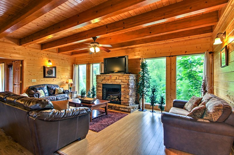 This Sevierville vacation rental home boasts a movie theater, arcade games, 2 living rooms and more!
