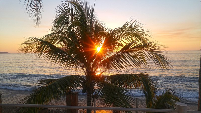 The sun setting right on your private beach front.
