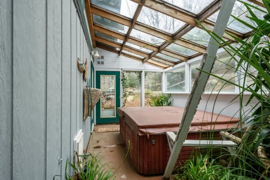 Hot tub conveniently located in the greenhouse