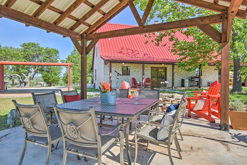 The gazebo hosts a dining table perfect for alfresco feasts.