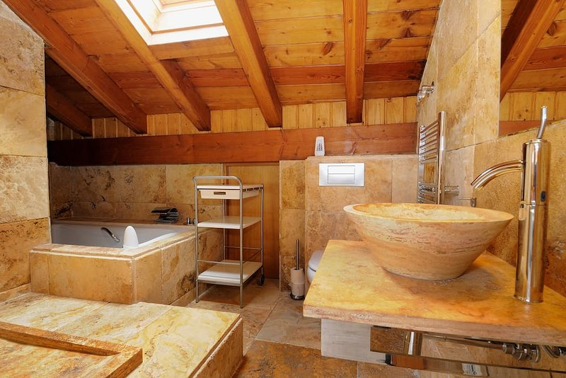 attic private bathroom with whirlpool.