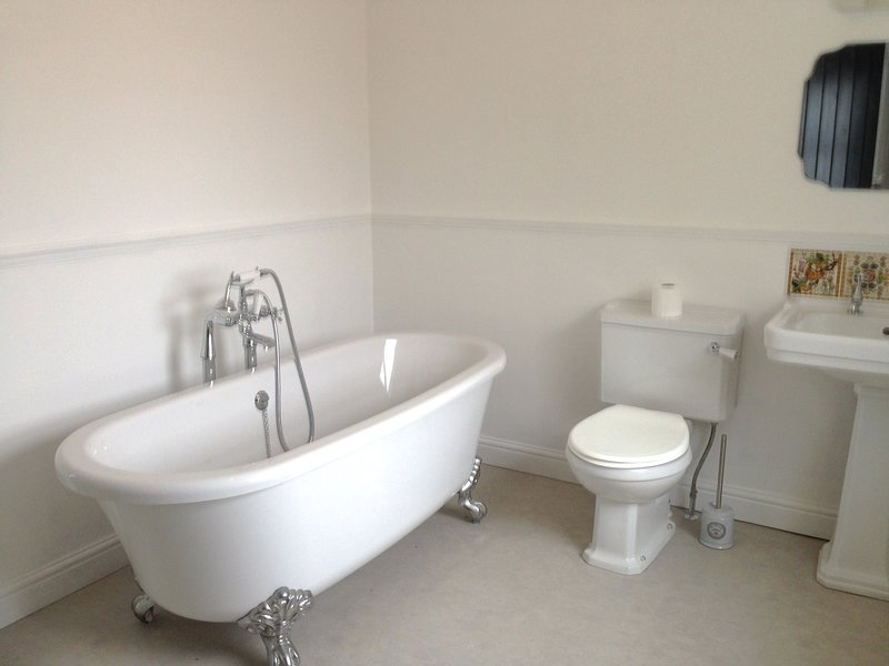 Free standing bath in main bathroom - another shower and toilet downstairs
