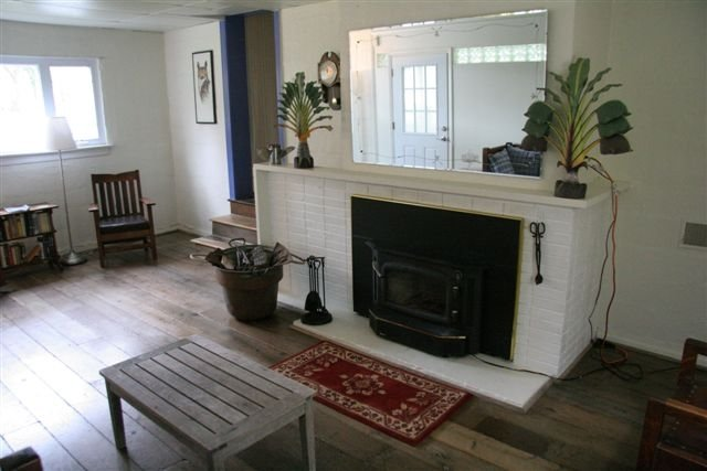 LIving room which includes California Single bed.