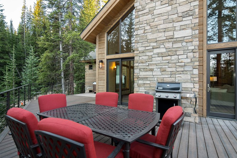 Large main level deck with gas grill and new outdoor seating