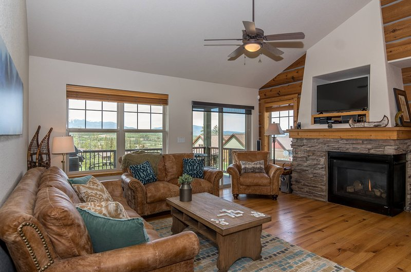 Main level lounge with expansive valley views, gas fireplace and flat screen TV