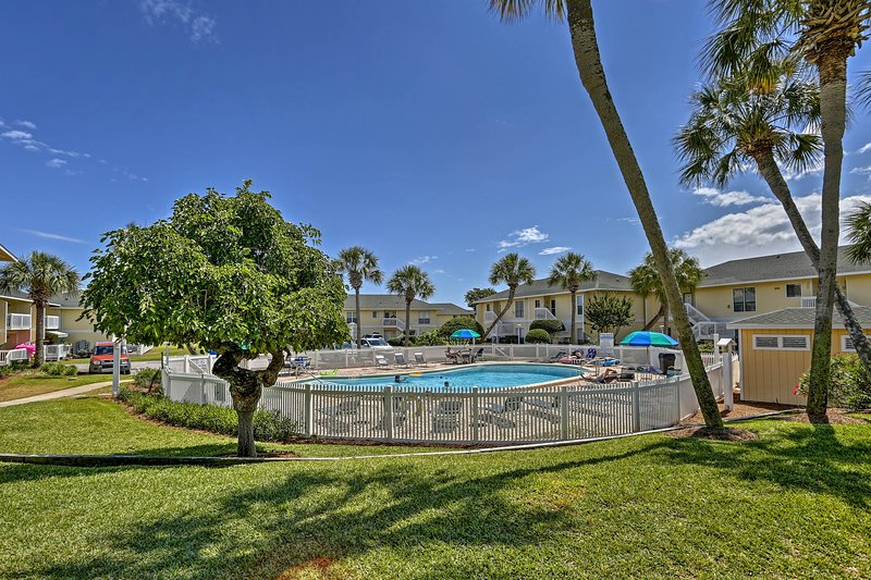 One of the 5 swimming pools is just steps from the Destin vacation rental home.