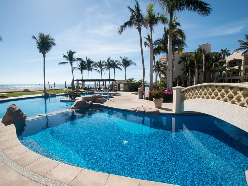 A view of one of the pools and the beach facing your ideal vacation condo!