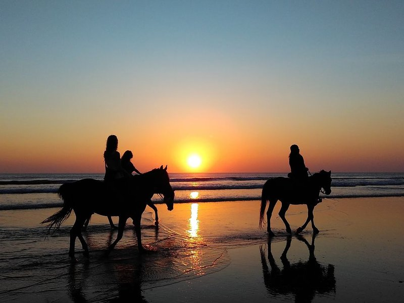 Sunset riding on the beach