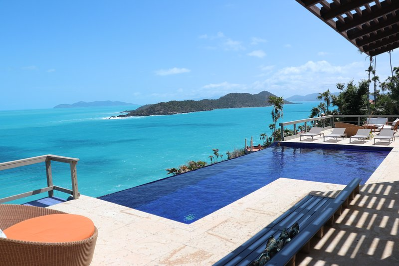 The beautiful infinity edge pool is just upstairs at the main villa level.
